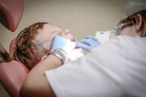 Child being examined by Hygienist