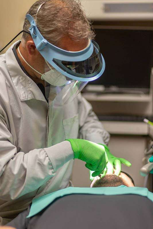 Dr. Zach working on Patient